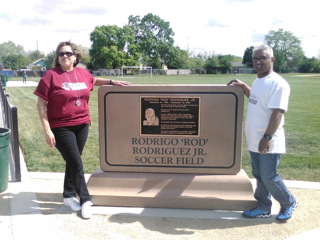 Rod's parents next to monument